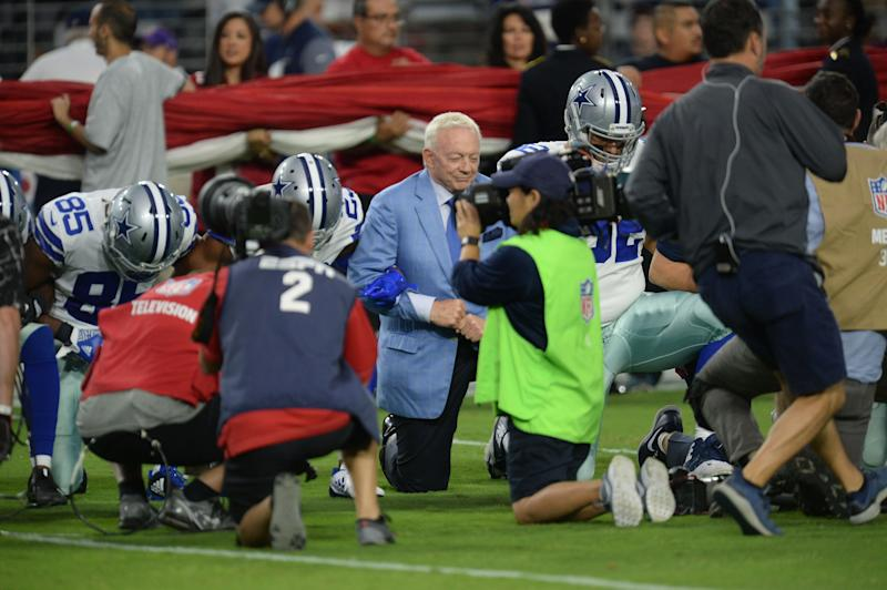 Sep 25, 2017; Glendale, AZ, USA; Dallas Cowboys owner Jerry Jones kneels with players prior to the national anthem prior to the game against the Arizona Cardinals at University of Phoenix Stadium. Mandatory Credit: Joe Camporeale-USA TODAY Sports