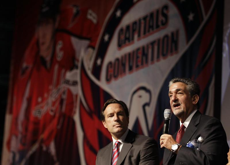 Washington Capitals majority owner Ted Leonsis, right, speaks as NHL Chief Operating Officer John Collins, left, looks on during the team's Capitals Convention, Saturday, Sept. 21, 2013, in Washington. Leonsis announced that the team will host the league's annual Winter Classic outdoor hockey game on New Year's Day in 2015. (AP Photo/Luis M. Alvarez)