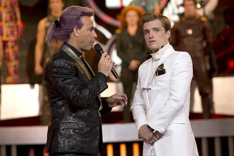 "This image released by Lionsgate shows Stanley Tucci as Caesar Flickerman, left, and Josh Hutcherson as Peeta Mellark in a scene from ""The Hunger Games: Catching Fire."" (AP Photo/Lionsgate, Murray Close)"