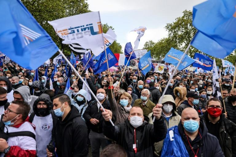Thousands of French police officers rallied in Paris Wednesday demanding better protection