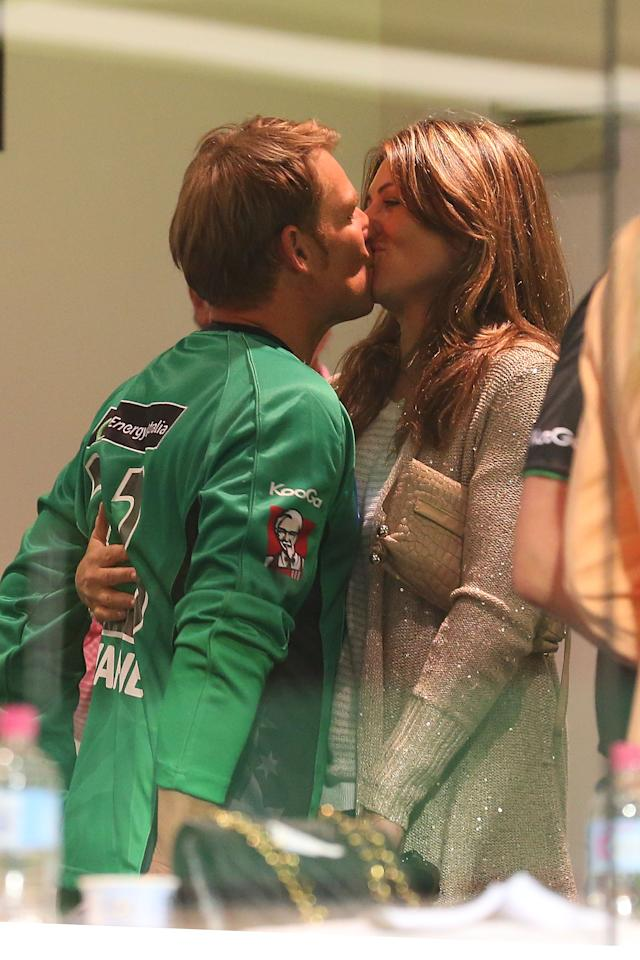 PERTH, AUSTRALIA - DECEMBER 12:  Shane Warne of the Stars kisses Liz Hurley in the players rooms after winning the Big Bash League match between the Perth Scorchers and the Melbourne Stars at WACA on December 12, 2012 in Perth, Australia.  (Photo by Paul Kane/Getty Images)
