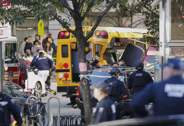 <p>Authorities respond near a damaged school bus on Oct. 31, 2017, in New York. A motorist drove onto a busy bicycle path near the World Trade Center memorial and struck several people on Tuesday police and witnesses said. (Photo: Bebeto Matthews/AP) </p>
