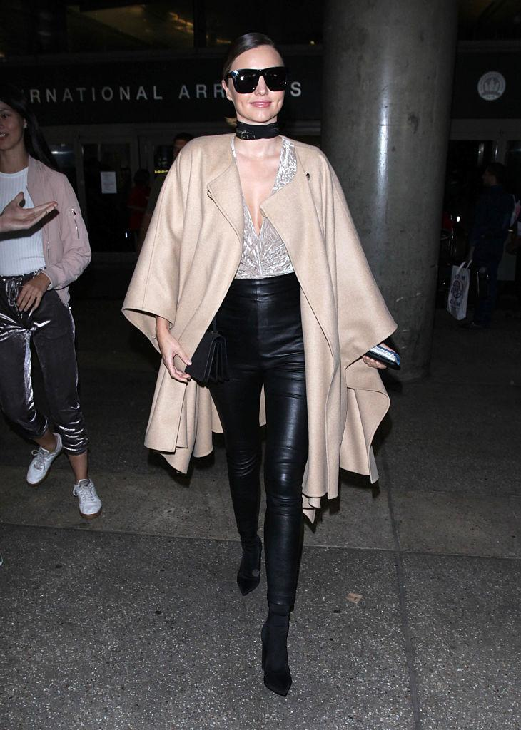 <p>Miranda is all of our #airportstyle goals in leather pants, a velvet top and an oversized cape. <i>(Photo by SMXRF/Star Max/GC Images)</i><br></p>