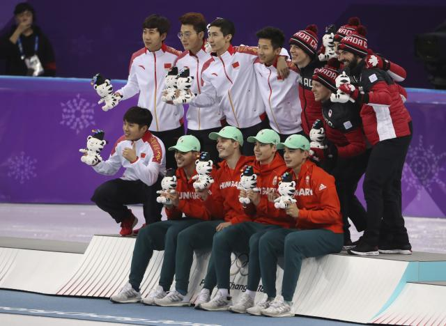 Short Track Speed Skating Events - Pyeongchang 2018 Winter Olympics - Men's 5000m Relay Final - Gangneung Ice Arena - Gangneung, South Korea - February 22, 2018 - Gold medallists, Team Hungary poses with silver medallists Team China and bronze medallist, Team Canada. REUTERS/Lucy Nicholson