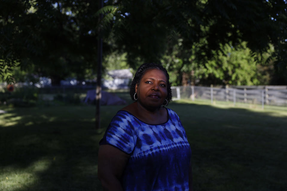 Pamela Davidson, a Knox County Board member, stands for a portrait in her yard in Galesburg, Ill., Monday, June 14, 2021. Davidson, 57, would love to see a federal infrastructure bill pour millions of dollars into the south Galesburg district she represents but she'd rather see that district redrawn for the first time in 60 years. (AP Photo/Shafkat Anowar)