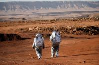 Scientists participate in a demonstration of an experiment led by Austrian and Israeli agencies simulating a mission to Mars near Mitzpe Ramon