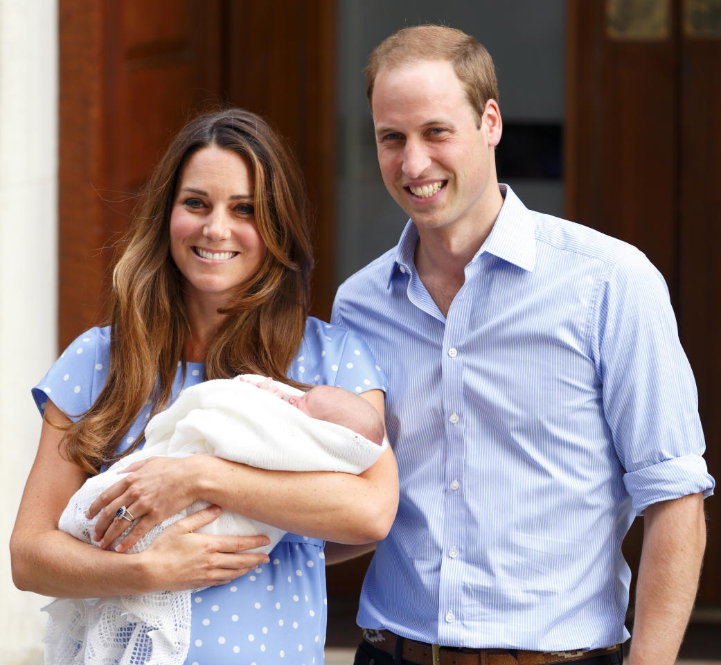 <p>Kate glowed in a blue polka-dot dress, while Prince William beamed in a blue shirt. (Photo: Getty Images) </p>