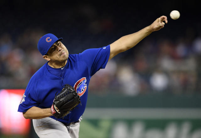 Chicago Cubs relief pitcher Jorge De La Rosa delivers during the fourth inning of the first baseball game of a doubleheader against the Washington Nationals, Saturday, Sept. 8, 2018, in Washington. (AP Photo/Nick Wass)