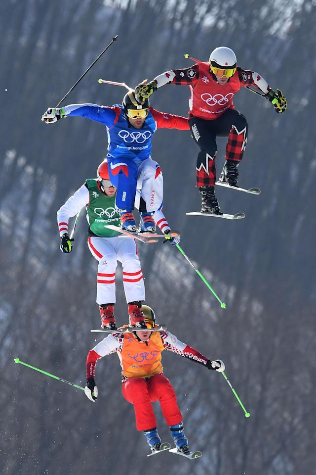 <p>Kevin Drury of Canada, Arnaud Bovolenta of France, Semem Denishchikov of Olympic athletes of Russia and Robert Winkler of Austria compete in the Freestyle Skiing Men's Ski Cross Quarterfinals on day 12 of the PyeongChang 2018 Winter Olympic Games at Phoenix Snow Park on February 21, 2018 in Pyeongchang-gun, South Korea. (Photo by Quinn Rooney/Getty Images) </p>