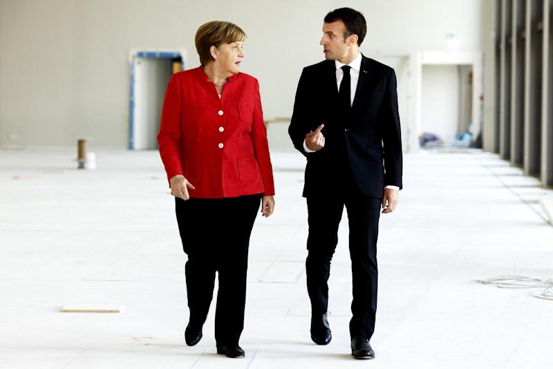 Politicians have called on Angela Merkel and Emmanuel Macron to boycott the World Cup: EPA