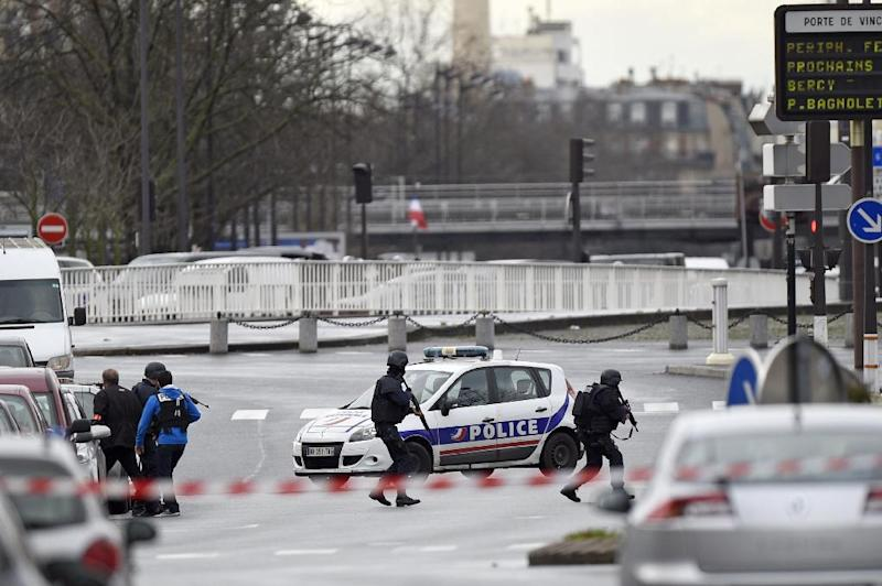 Police forces gather together at Porte de Vincennes, east of Paris, after at least one person was injured when a gunman opened fire at a kosher grocery store on January 9, 2015 and took at least five people hostage