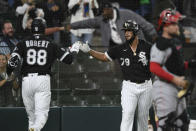Chicago White Sox's Luis Robert (88) celebrates with teammate Jose Abreu (79) after hitting a solo home run during the first inning of a baseball game against the Cincinnati Reds Tuesday, Sept. 28, 2021, in Chicago. (AP Photo/Paul Beaty)