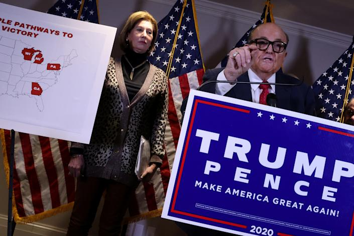 Sidney Powell, an attorney later disavowed by the Trump campaign, participates in a news conference with U.S. President Donald Trump's personal lawyer Rudy Giuliani at the Republican National Committee headquarters on Capitol Hill in Washington on November 19, 2020. (Jonathan Ernst/Reuters)