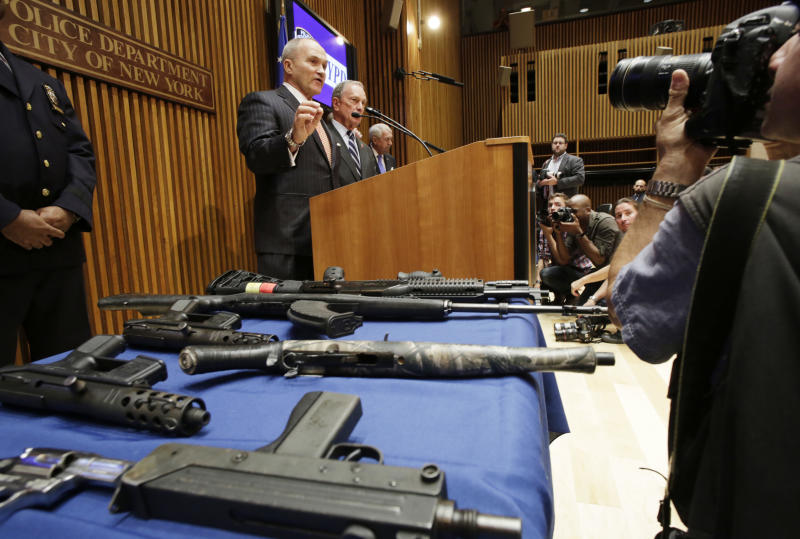 New York Police Commissioner Raymond Kelly, left, and Mayor Michael Bloomberg announce the arrest of 19 people and seizure of 254 guns as part of gun smuggling between the Carolinas and New York, Monday, Aug. 19, 2013. Authorities say couriers smuggled 254 guns into New York City by stashing weapons in their luggage on discount buses. (AP Photo/Mark Lennihan)