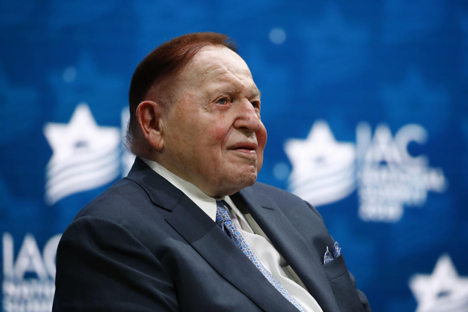 FILE - In this Dec. 7, 2019, file photo, Las Vegas Sands Corporation Chief Executive Sheldon Adelson sits onstage before President Donald Trump speaks at the Israeli American Council National Summit in Hollywood, Fla. One of the most influential Republican megadonors, Adelson, died Jan. 11, 2021. That puts more pressure on the NRSC and the leading Senate Republican outside group, Senate Leadership Fund, to cover the difference. (AP Photo/Patrick Semansky, File)