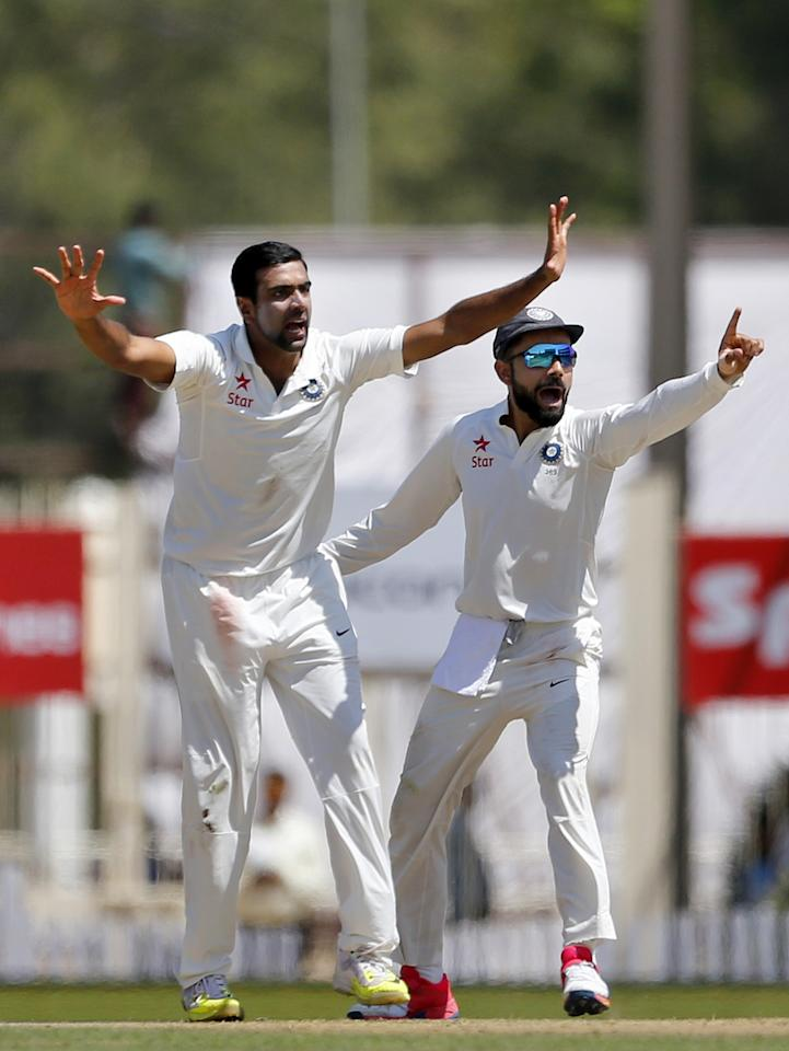 <p>India's Ravichandran Ashwin, left, and captain Virat Kohli appeal for the wicket of Australia's Shaun Marsh during the first day of their third test cricket match in Ranchi, India, Thursday, March 16, 2017. (AP Photo/Aijaz Rahi) </p>