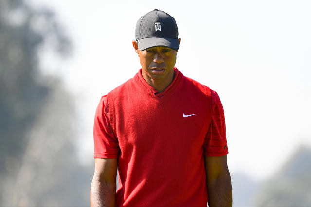 """<a class=""""link rapid-noclick-resp"""" href=""""/pga/players/147/"""" data-ylk=""""slk:Tiger Woods"""">Tiger Woods</a>' ailing back is sidelining him for The Players Championship. (Photo by Brian Rothmuller/Icon Sportswire via Getty Images)"""