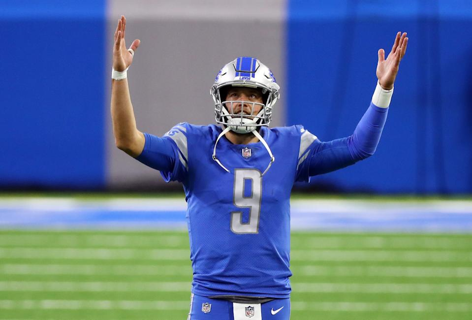 Matthew Stafford of the Detroit Lions signals for a touchdown during the second half against the Green Bay Packers at Ford Field on Dec. 13, 2020.