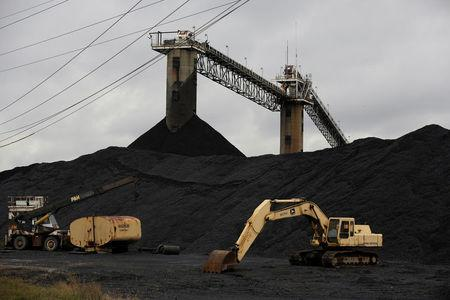 Earth moving equipment sits by a coal pile at the Century Mine in Beallsville, Ohio, U.S., November 7, 2017.   REUTERS/Joshua Roberts