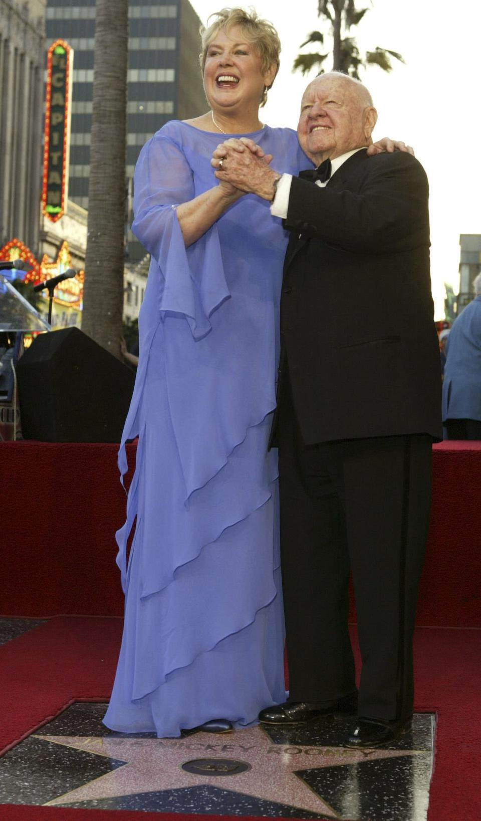 Actor Mickey Rooney and his wife Jan dance on their star after it was unveiled on the Hollywood Walk of Fame in Hollywood in this April 26, 2004 file photo. Rooney, the pint-sized screen dynamo of the 1930s and 1940s best known for his boy-next-door role in the Andy Hardy movies, died on April 6, 2014 at 93, the TMZ celebrity website reported. It did not give a cause of death and a spokesman was not immediately available for comment. REUTERS/Lucy Nicholson/Files (UNITED STATES - Tags: ENTERTAINMENT OBITUARY)