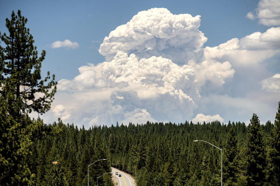 Seen from Truckee, Calif., about 50 miles away, a smoke plume rises from the Sugar Fire, part of the Beckwourth Complex Fire, burning in Plumas National Forest on Friday, July 9, 2021. (AP Photo/Noah Berger)
