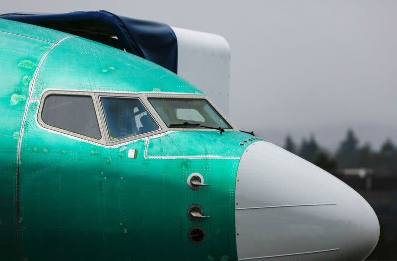 A Boeing 737 Max aircraft is seen parked in a storage area at the company's production facility in Renton