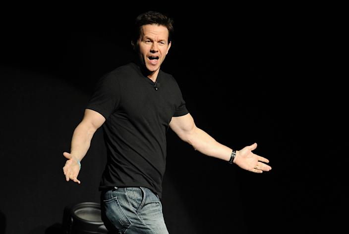 """Mark Wahlberg, a cast member in the upcoming film """"Transformers: Age of Extinction,"""" arrives onstage at the Opening Night Presentation from Paramount Pictures at CinemaCon 2014 on Monday, March 24, 2014, in Las Vegas. (Photo by Chris Pizzello/Invision/AP)"""