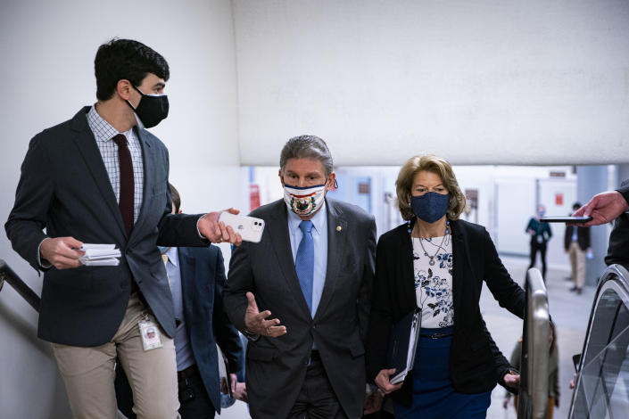 WASHINGTON, DC - FEBRUARY 23: Sen. Joe Manchin (D-WV) and Sen. Lisa Murkowski (R-AK) speak as they arrive to vote in the U.S. Capitol on February 23, 2021 in Washington, DC. The Senate held confirmation hearings today for multiple Biden administration nominees as well as a hearing regarding the January 6 attack on the U.S. Capitol.  (Photo by Al Drago/Getty Images)
