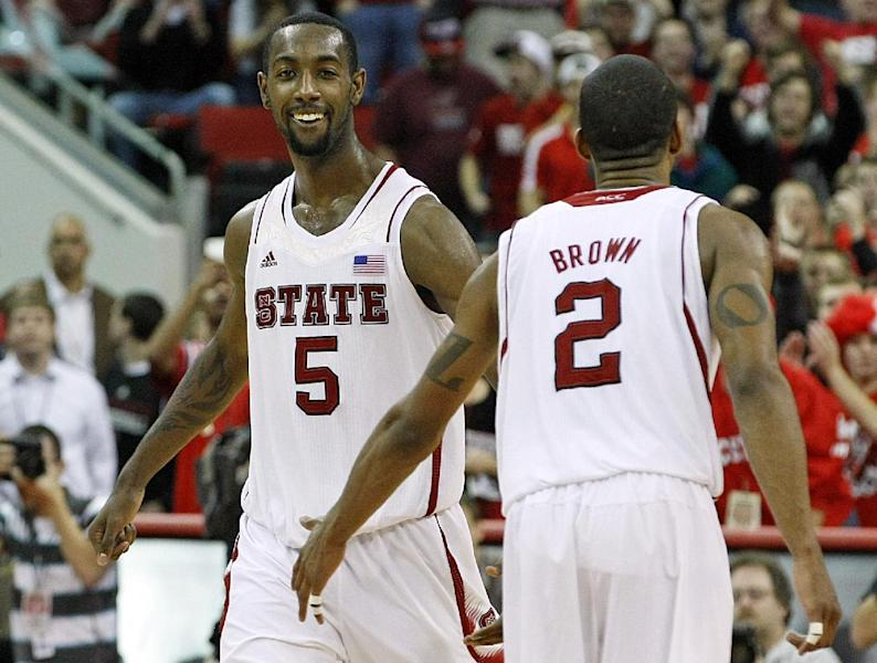 North Carolina State's C.J. Leslie (5) celebrates with teammate Lorenzo Brown (2) during the final minutes of an NCAA college basketball game against Duke in Raleigh, N.C., Saturday, Jan. 12, 2013. N.C. State defeated No. 1 Duke 84-76. (AP Photo/Karl B DeBlaker)