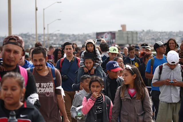 <p>Members of a caravan of migrants from Central America walk towards the United States border and customs facility, where they are expected to apply for asylum, in Tijuana, Mexico April 29, 2018. (Photo: Edgard Garrido/Reuters) </p>