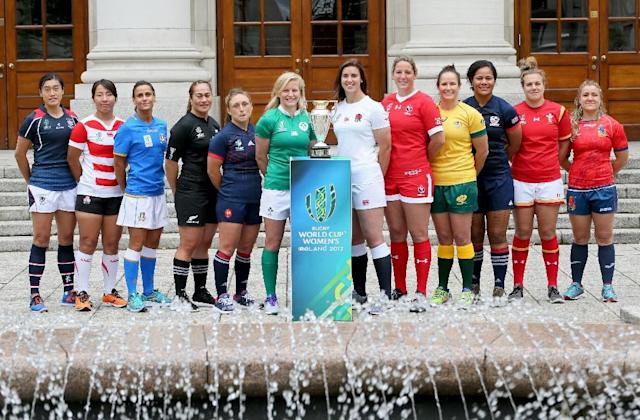 (L-R) Captains from Hong Kong, Japan, Italy, New Zealand, France, Ireland, England, Canada, Australia, US Wales and Spain pose with the trophy in Dublin ahead of the women's rugby union World Cup on August 6, 2017 (AFP Photo/Paul FAITH)