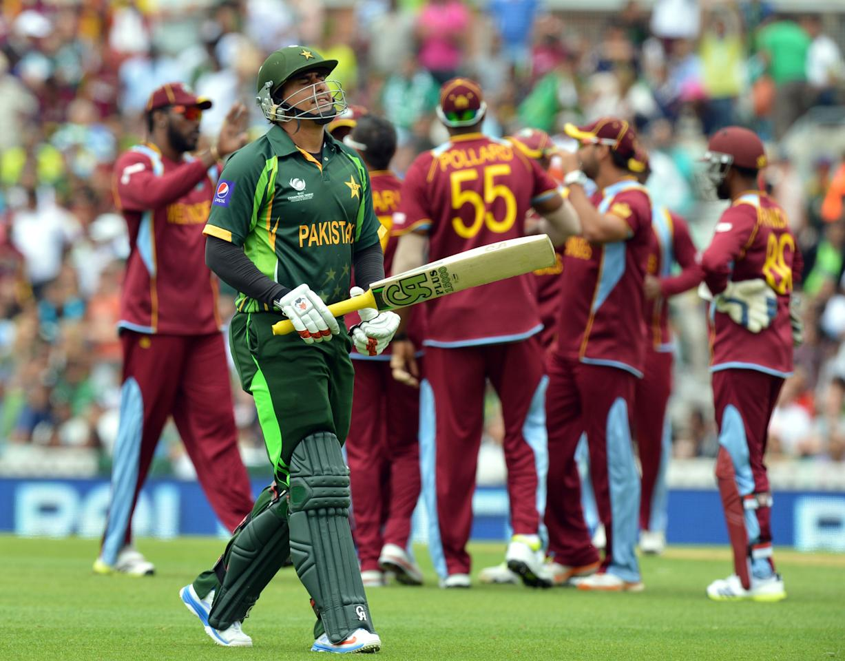 Pakistan's Misbah-ul-Haq leaves the field after losing his wicket for 50 runs during the ICC Champions Trophy match at The Oval, London.