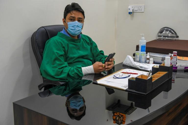 Davinder Kundra is among a growing number of doctors who are worried as New Delhi's notorious air again hits peak pollution levels while a new pandemic wave is battering hospitals