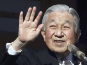 Japan's Emperor Akihito waves to well-wishers from the bullet-proofed balcony during his New Year's public appearance with his family members at Imperial Palace in Tokyo Wednesday, Jan. 2, 2019. (AP Photo/Eugene Hoshiko)
