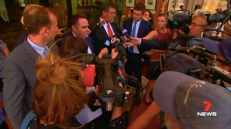 Ben McCormack and his lawyer face the media scrum outside court on Friday. Source: 7 News