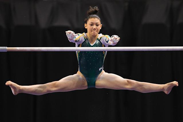 ST. LOUIS, MO - JUNE 8: Kyla Ross competes on the uneven bars during the Senior Women's competition on day two of the Visa Championships at Chaifetz Arena on June 8, 2012 in St. Louis, Missouri. (Photo by Dilip Vishwanat/Getty Images)
