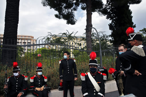 A brass band wait before to perform during the start of the first stage of the Tour de France cycling race over 156 kilometers (97 miles) with start and finish in Nice, southern France, Saturday, Aug. 29, 2020. (AP Photo/Christophe Ena)