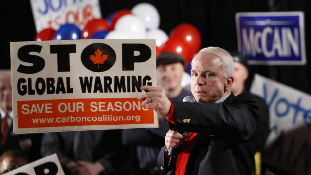 <p>Republican presidential hopeful Sen. John McCain, R-Ariz., holds up a climate change awareness poster as he speaks at a campaign rally in Portsmouth, N.H., Jan. 7, 2008. (Photo: Charles Dharapak/AP) </p>