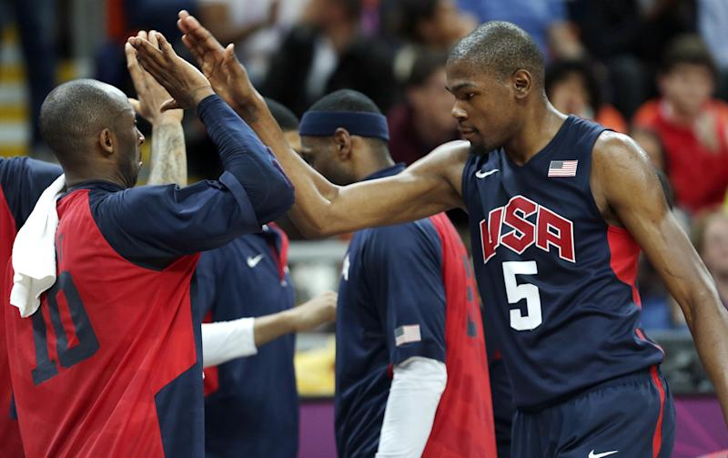 USA's Kevin Durant, right, is congratulated by teammate Kobe Bryant during a men's basketball game against Argentina at the 2012 Summer Olympics, Monday, Aug. 6, 2012, in London. (AP Photo/Charles Krupa)