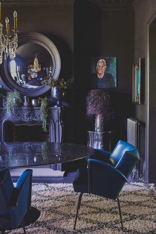 """<p>""""I've kept the palette quite restrained in this area, which means I can easily mix 1950s blue Italian chairs, with super large raffia lamps, supersized mirrors and twinkly chandeliers.""""</p>"""