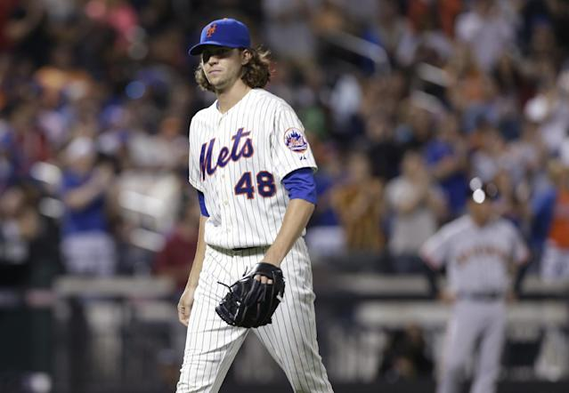 New York Mets starting pitcher Jacob deGrom leaves the field during the eighth inning of a baseball game against the San Francisco Giants Saturday, Aug. 2, 2014, in New York. (AP Photo/Frank Franklin II)
