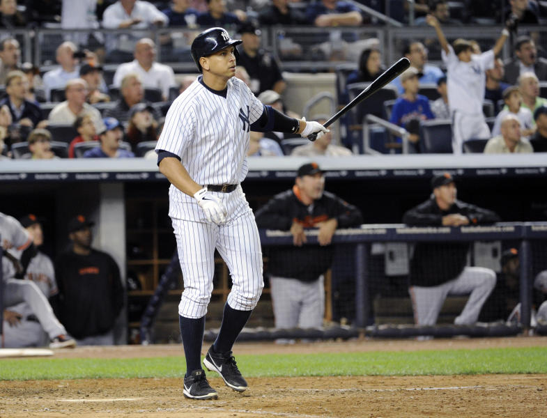 New York Yankees' Alex Rodriguez watches his grand slam during the seventh inning of an interleague baseball game against the San Francisco Giants, Friday, Sept. 20, 2013, at Yankee Stadium in New York. (AP Photo/Bill Kostroun)