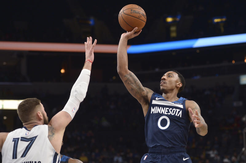 Minnesota Timberwolves guard Jeff Teague (0) shoots against Memphis Grizzlies center Jonas Valanciunas (17) during the first half of an NBA basketball game Tuesday, Jan. 7, 2020, in Memphis, Tenn. (AP Photo/Brandon Dill)