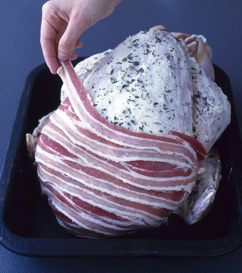 "<p>""Smother your turkey in butter, then layer streaky bacon over it the night before it goes in the oven"", says Chloe who writes <a rel=""nofollow"" href=""https://gastronomicgorman.com/"">The Gastronomic Gorman</a>. ""That will keep it lovely and moist while it cooks."" [Photo: Food and Drink/REX/Shutterstock] </p>"