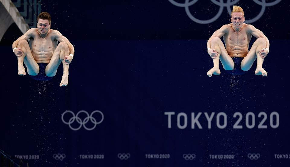 <p>USA's Mike Hixon and USA's Andrew Capobianco compete in the men's synchronised 3m springboard diving final event during the Tokyo 2020 Olympic Games at the Tokyo Aquatics Centre in Tokyo on July 28, 2021. (Photo by Odd ANDERSEN / AFP) (Photo by ODD ANDERSEN/AFP via Getty Images)</p>
