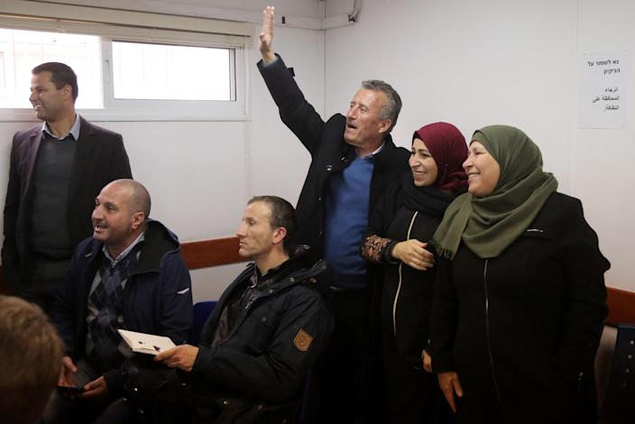 Bassem Tamimi, standing with relatives, waves as his 16-year-old daughter, Ahed, appears at a military court in Ramallah, Jan. 17, 2018. (Photo: Issam Rimawi/Anadolu Agency/Getty)