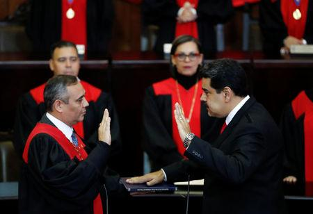 Venezuela's President Nicolas Maduro is sworn in by Venezuela's Supreme Court President Maikel Moreno, during the ceremonial swearing-in for his second presidential term, at the Supreme Court in Caracas, Venezuela January 10, 2019. REUTERS/Carlos Garcia Rawlins