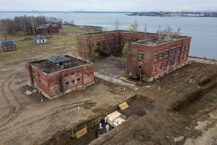 An arial view shows bodies being buried on New York's Hart Island where the department of corrections is dealing with more burials overall, amid the coronavirus disease (COVID-19) outbreak in New York City, U.S., April 9, 2020.
