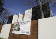 FILE - In this Aug. 13, 2018, file photo, a house is pictured for sale in Christchurch, New Zealand. New Zealand's government on Thursday, Feb. 25, 2021 made the first of several promised moves to rein in skyrocketing house prices by ordering the nation's Reserve Bank to consider the impact on housing when making decisions. (AP Photo/Mark Baker, File)