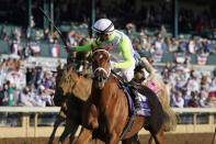 Florent Geroux rides Monomoy Girl to win the Breeders' Cup Distaff horse race at Keeneland Race Course, in Lexington, Ky., Saturday, Nov. 7, 2020. (AP Photo/Darron Cummings)